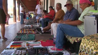 Native Americans sell their crafts and wares to tourists on the streets of Santa Fe, New Mexico.
