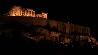 Night shot of the Acropolis and Parthenon on the hilltop in Athens, Greece.