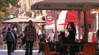 Pedestrians crowd the cafes and modern streets in the new city of Jerusalem, Israel.