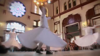 Stylish slow motion shot of whirling dervishes perform a mystical dance in Istanbul, Turkey.