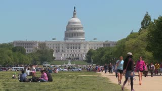 Summertime in Washington DC brings out tourists near the Capitol Dome.