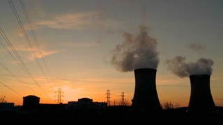 Sunset behind a nuclear power plant.