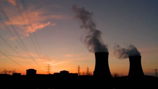 Sunset behind nuclear power plant.