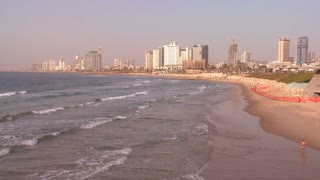 Tel Aviv, Israel with waves breaking on the shore.