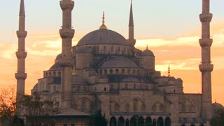 The Blue Mosque in Istanbul, Turkey in red orange sunset light.
