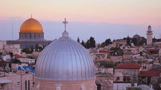 The Dome of the Rock is framed with Christian churches and mosques over the skyline of the Old City of Jerusalem.