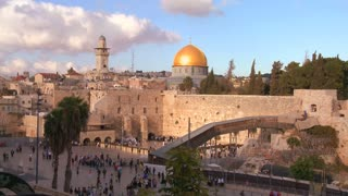The Dome of the Rock towers over the Old City of Jerusalem and the Wailing Wall.