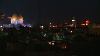 The Dome of the Rock towers over the Old City of Jerusalem at night.