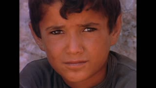 The faces of young children in Syria in 1996.