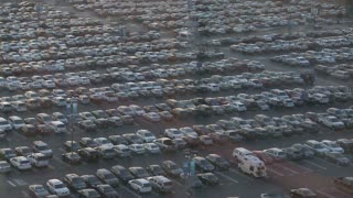 Thousands of cars in a crowded parking lot.