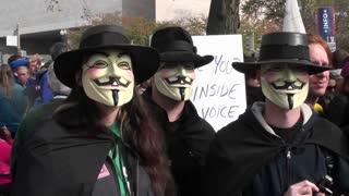 Three masked men posing at the Jon Stewart rally in Washington DC.