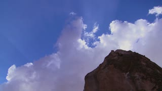 Time lapse of clouds and sun rays over strange towering dwellings and rock formations at Cappadocia, Turkey.