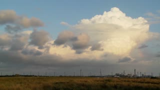 Time Lapse of clouds over an oil refinery.