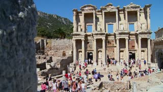Tourists walk amongst the ruins at Ephesus, Turkey.
