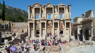 Tourists walk down the main thoroughfare  at Ephesus, Turkey.