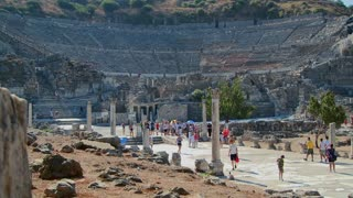 Tourists walk near the Coliseum at Ephesus, Greece.