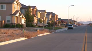Tract homes line a street in a suburban sprawl community near Palmdale, California.