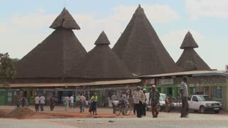 Unusual thatch roof structures in Kenya are a community market.