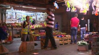 Vendors at market stalls in East Jerusalem.