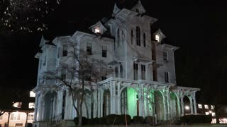 Night scene establishing shot of an old Victorian haunted house.