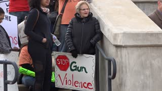 Protestors hold signs against gun violence in schools during the March For Our Lives Protest.