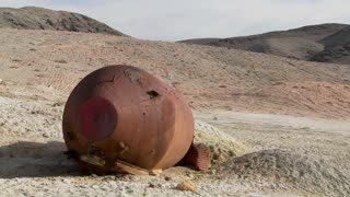 What looks like an old space capsule has crash landed in the desert.