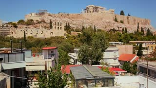 Wide establishing shot of Athens, Greece to reveal Acropolis and Parthenon.