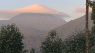 xA strange cloud forms at the summit of the Virunga Volcano chain on the Rwanda Congo border,