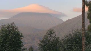 xA strange cloud forms at the summit of the Virunga Volcano chain on the Rwanda Congo border,