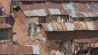 Zoom out from a poverty stricken slum on the outskirts of Nairobi, Kenya.