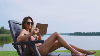 A slender young brunette on vacation is looking for tours for further travel to the Islands