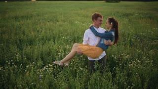 boyfriend and girlfriend kissing in the field