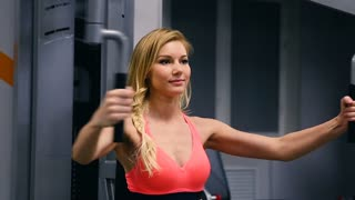 Caucasian sexy pretty fitness girl on diet training chest pumping up beautiful breast