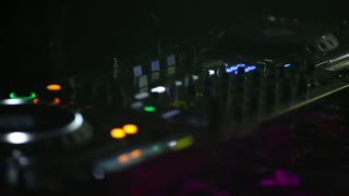 DJ working night clubs for remote control sound control