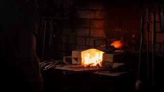 Hardening of the metal by sharp cooling in water. There is steam. The blacksmith tempers a red-hot sword on an old technology. Creation of ancient weapons. Blacksmith's Armory.