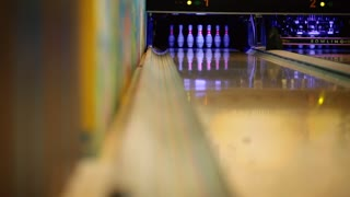 In the game club for bowling, the player throws a bowling ball that knocks down skittles. Knocked pins and was left alone