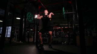 Mujdchin squats and picks up the bar above his head. complex exercise