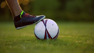 Soccer shoes football on the green grass