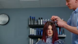 The color palette, and choose the hair color.  Hairdresser advises the client the color of hair dyes