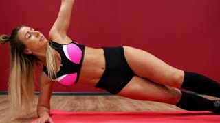 Two beautiful sports girls perform an active fat-burning workout jumping like a kangaroo in special fitness shoes. Cardio workout for endurance. Exercise the side bar into your hand movement and turn