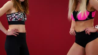 Two beautiful sports girls perform an active fat-burning workout jumping like a kangaroo in special fitness shoes. Cardio workout for endurance. kango jump