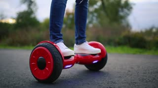 young man riding on the Hoverboard in the park. content technologies. a new movement. Close Up of Dual Wheel Self Balancing Electric Skateboard Smart