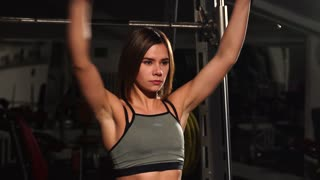Young woman stretching her arms before gym workout.