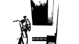 surveillance camera caught the thief broke the door and stole the bike. threshold effect