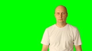 Adult white caucasian man gestures with green screen. Draw line touch tap virtual screen. Upper half close-up shot. Male in white t-shirt. Clip with Premultiplied matted Alpha Channel.