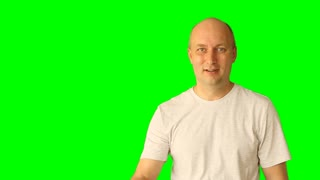 Adult white caucasian man gestures with green screen. Looking up thinking threaten fist hand finger. Upper half close-up shot. Male in white t-shirt. Clip with Premultiplied matted Alpha Channel.