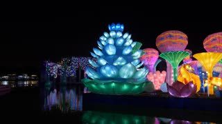 Dubai, UAE - January 13, 2018: seaweed and seahorses with beautiful multicolored backlight in magical garden with night light reflecting in lake water Glow park in Dubai city UAE.