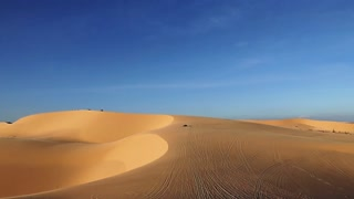 Jeep rides through the desert.