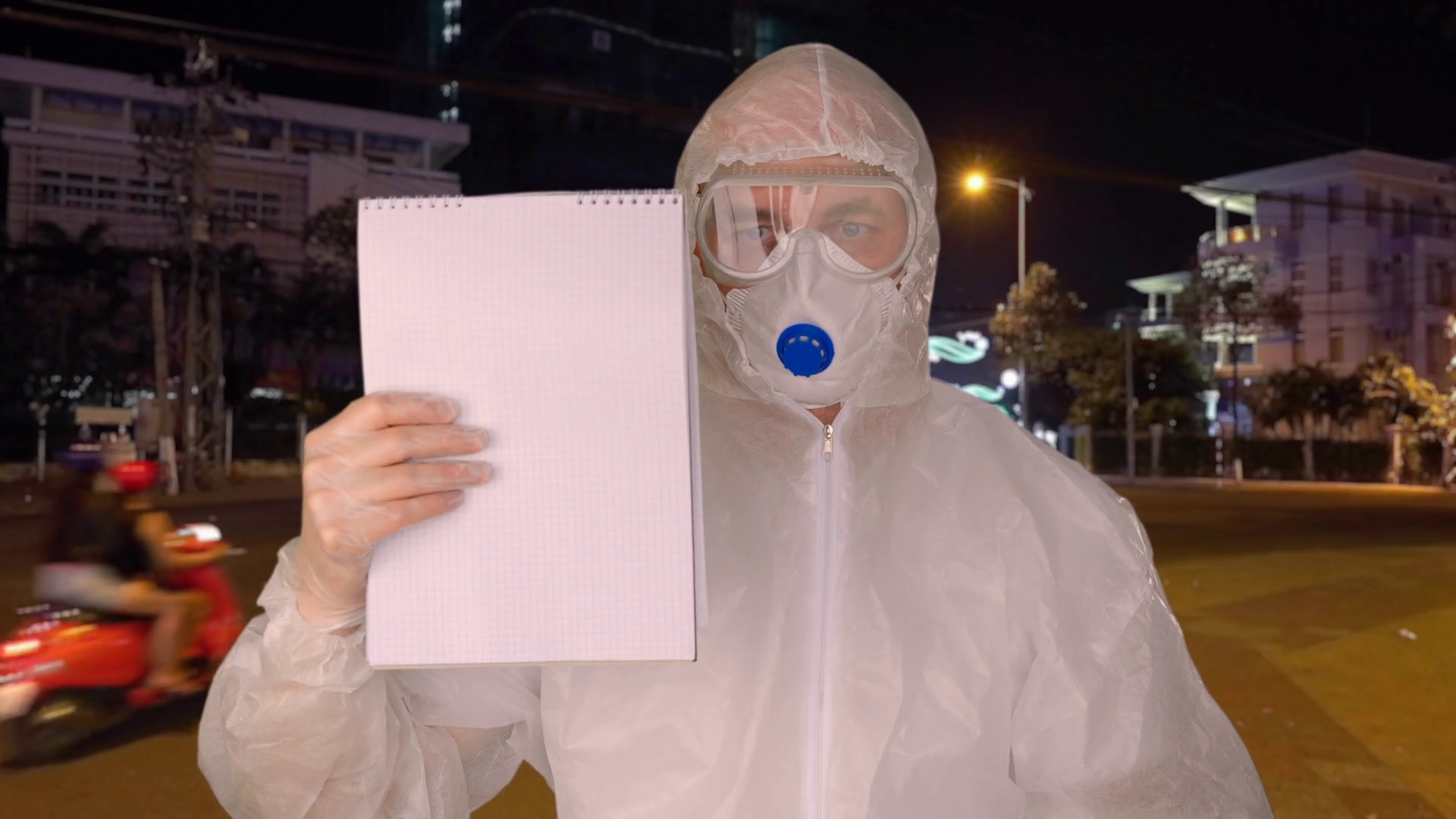 Man In Protective Costume And Mask Showing Stop Coronavirus Sign In Clipboard On Asian City Street Virologist In Protective Suit Warning About Covid 19 In Asian Resort Global Epidemic Corona Virus Stock Video