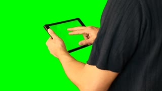 Man using tablet with green screen doubled on big screen 1 from 5. Chroma key green screen. HD.